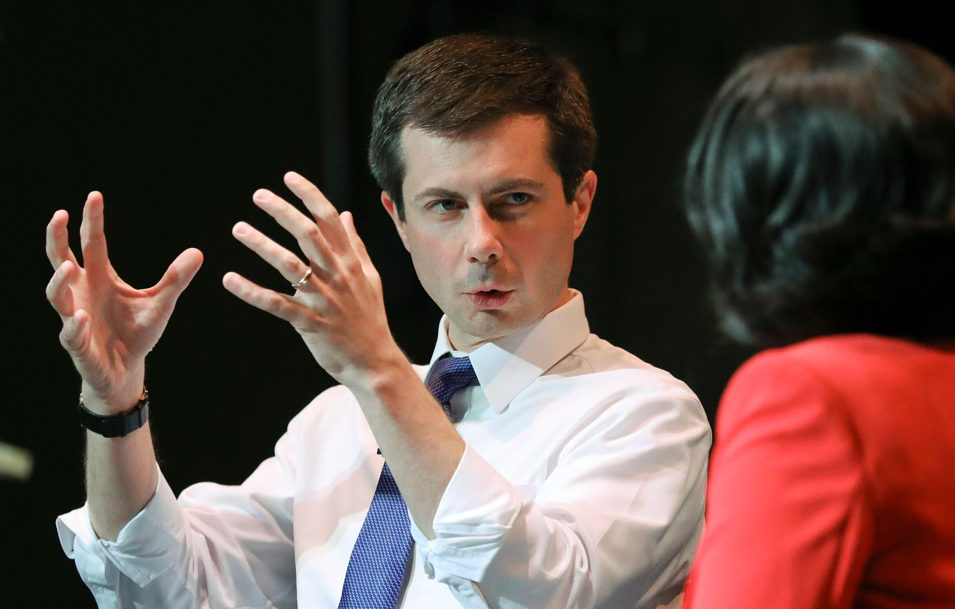 "Democratic presidential candidate Mayor Pete Buttigieg, left, South Bend, Indiana, speaks with NY1 news anchor Cheryl Wills, during the Queens Democratic party's first in a series of ""presidential fireside chat""-- a town hall forum meant to bring candidates before the country's most diverse county, Wednesday May 22, 2019, at LaGuardia Community College in New York. (AP Photo/Bebeto Matthews)"