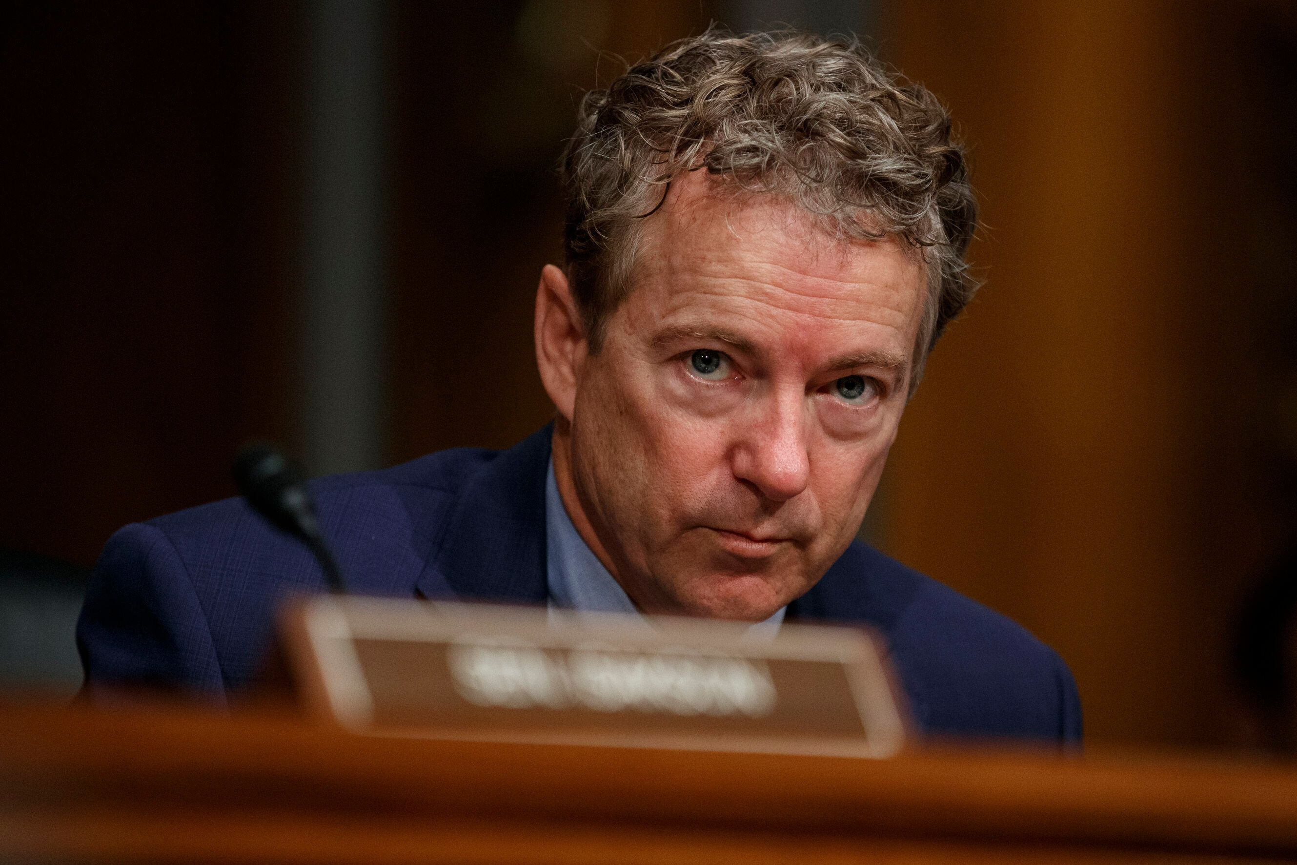 File-This March 5, 2019, file photo shows Sen. Rand Paul, R-Ky., pausing during a Senate Committee on Health, Education, Labor, and Pensions hearing on Capitol Hill in Washington.  A Kentucky judge has denied a request for a new trial from a man who a jury said should pay more than $580,000 to Paul for injuries Paul suffered when he was tackled by the man. The Daily News of Bowling Green reports Special Judge Tyler Gill rejected a motion Thursday, March 21, 2019, from Rene Boucher's lawyer and said the jury award wasn't excessive considering Boucher's conduct and Paul's injuries. (AP Photo/Carolyn Kaster, File)