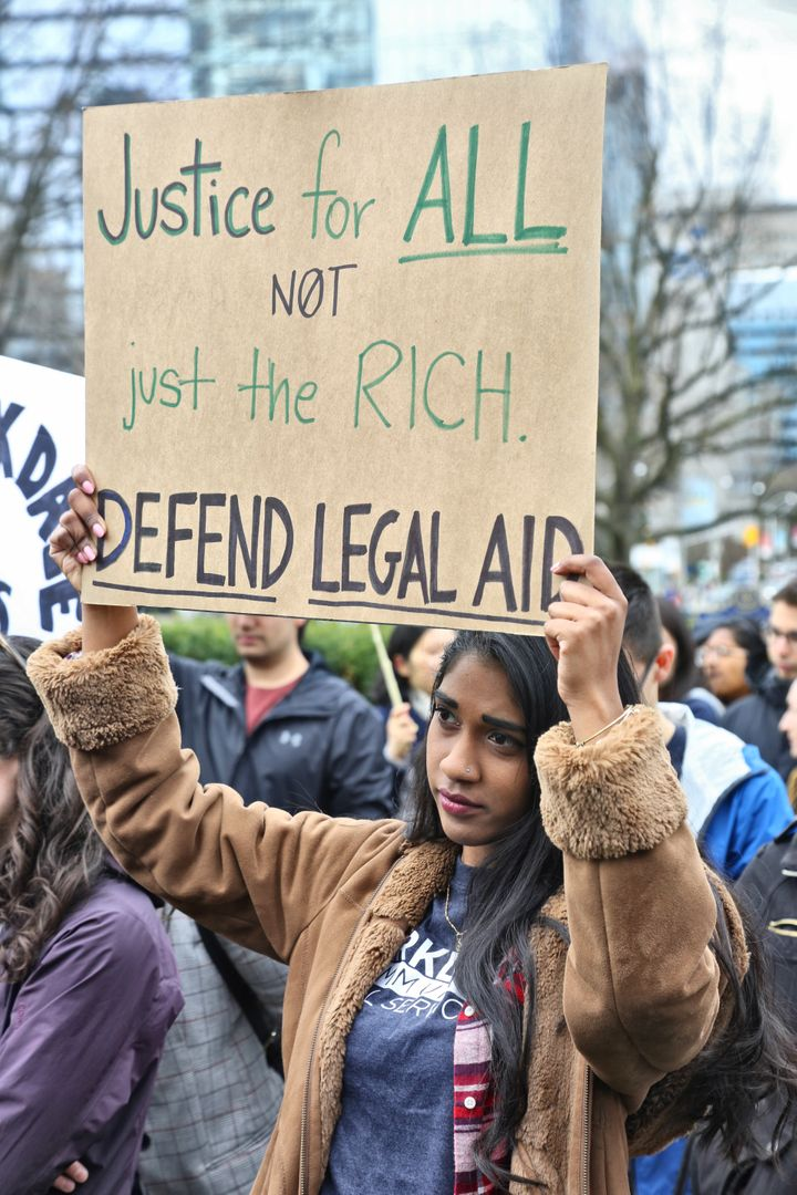 Lawyers and doctors along with members of the community gathered at Queen's Park to protest cuts to the Legal Aid Ontario May 7, 2019.