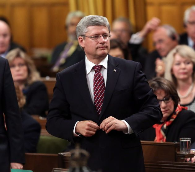 Former prime minister Stephen Harper votes against Stephen Woodworth's motion in the House of Commons...