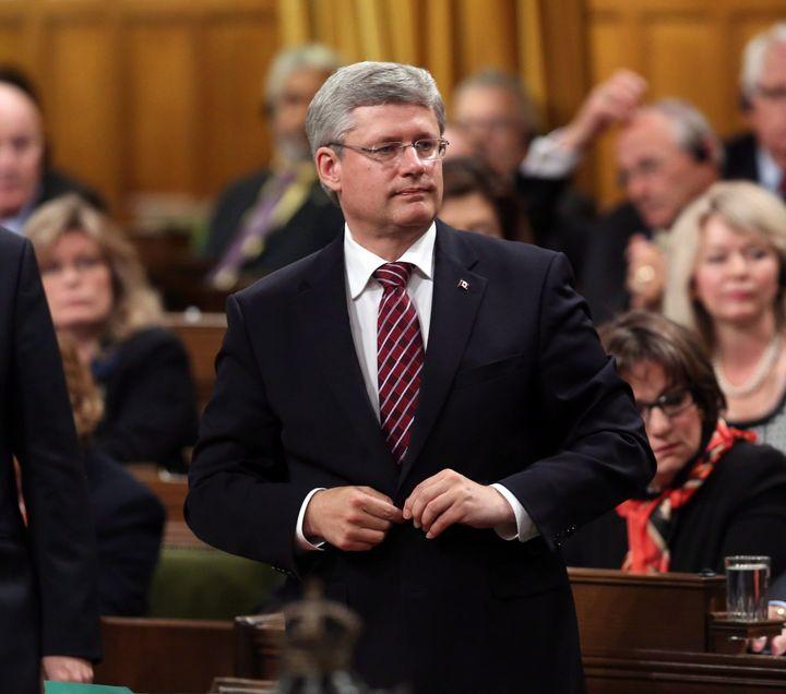 Former prime minister Stephen Harper votes against Stephen Woodworth's motion in the House of Commons on Sept. 26, 2012.