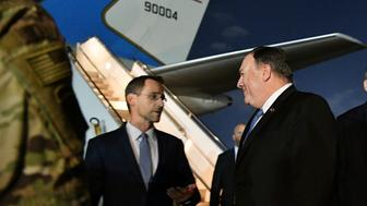 In this May 7, 2019 photo, Secretary of State Mike Pompeo, center, talks with Charge D'affaires at the US Embassy in Baghdad Joey Hood, left, after he arrived in Baghdad, for meetings. A senior officer in the U.S.-led military coalition combating the Islamic State says there is no increased threat from Iranian-backed forces in Iraq or Syria. British Maj. Gen. Chris Ghika, speaking from coalition headquarters in Baghdad, made the remark to reporters at the Pentagon in a video teleconference Tuesday. Last week, Pompeo abruptly canceled a scheduled visit to Germany to show support for the Iraqi government and underscore its need to protect Americans in the country.  (Mandel Ngan/Pool Photo via AP)