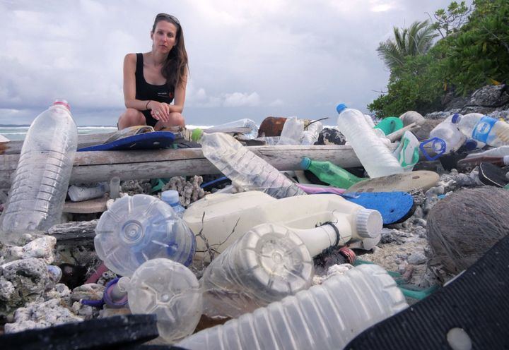 Jennifer Lavers pictured with plastic trash on the Cocos Islands.