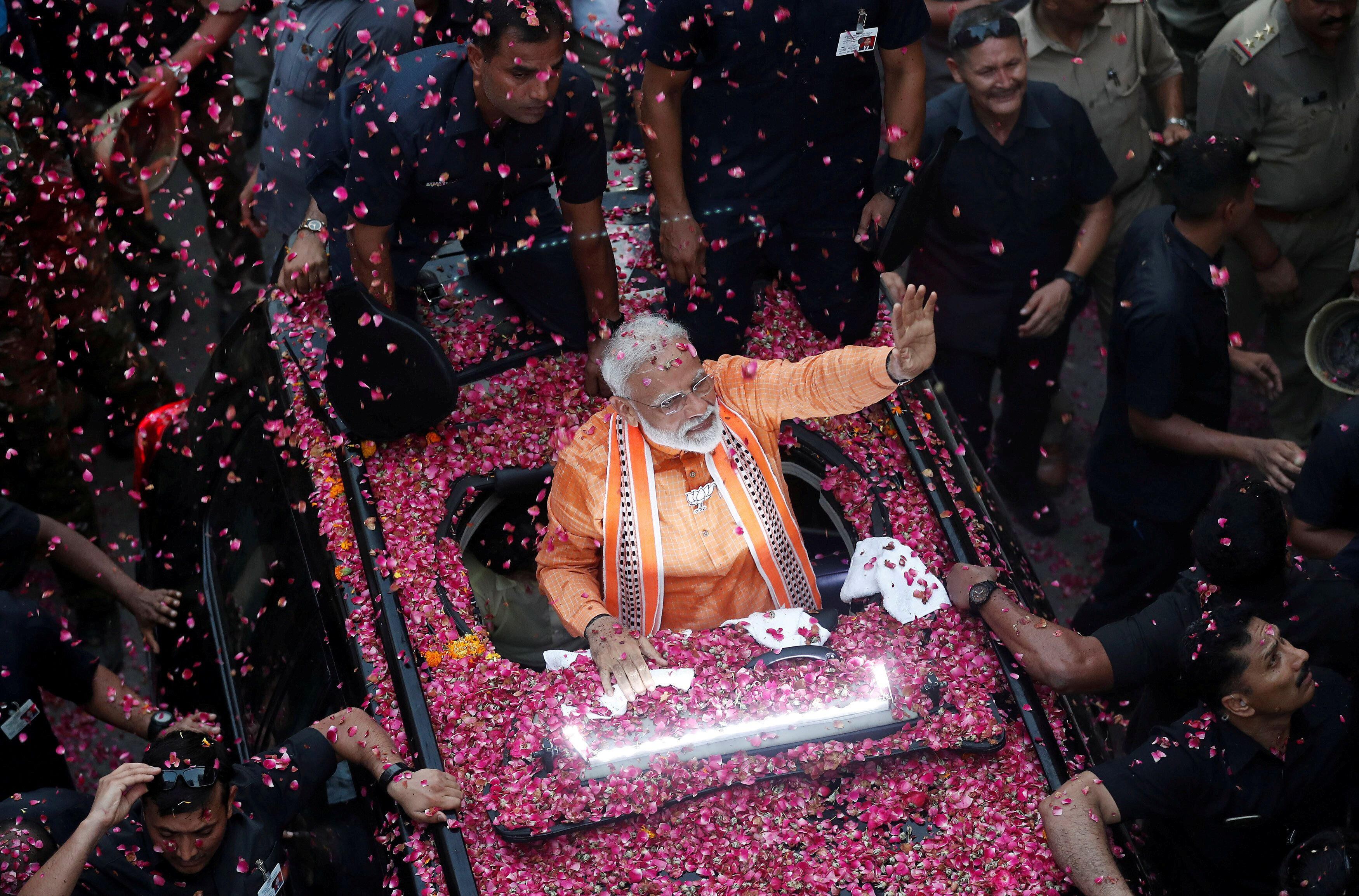 India's Prime Minister Narendra Modi waves towards his supporters during a roadshow in Varanasi, India, April 25, 2019. REUTERS/Adnan Abidi TPX IMAGES OF THE DAY