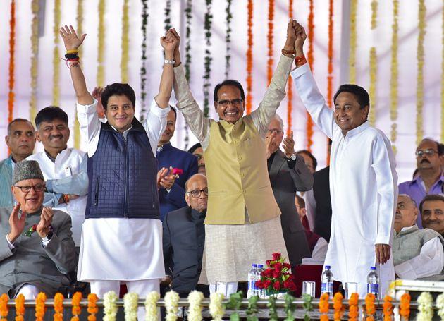 (L-R) Jyotiraditya Scindia, Shivraj Singh Chouhan (C), former Chief Minister of Madhya Pradesh state,...