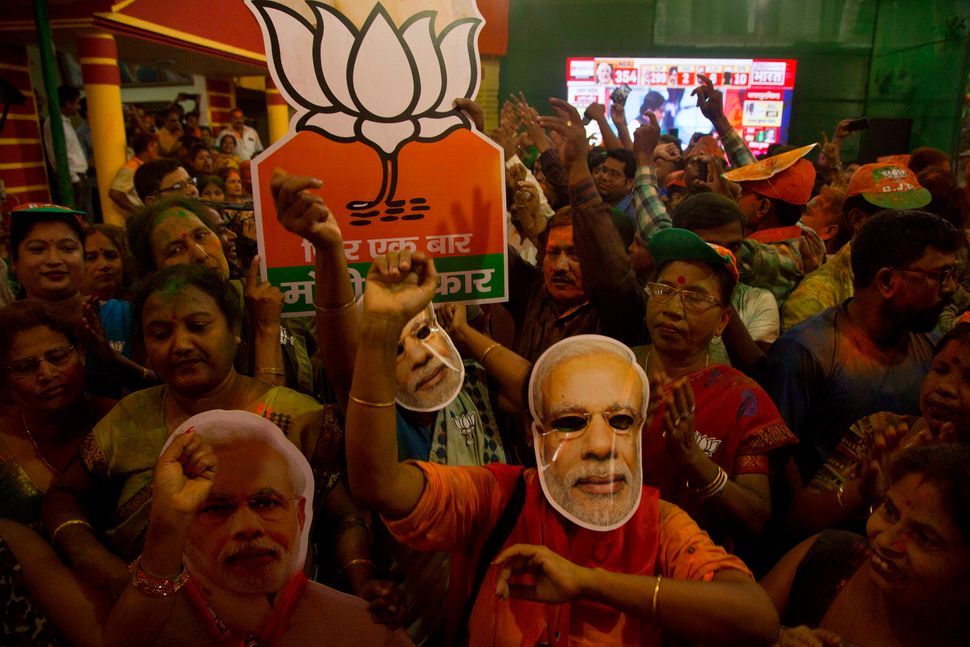 BJP supporters celebrate in their party's Assam state office in Gauhati, India, on May 23, 2019.