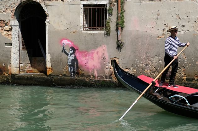 Banksy Takes Shot At Overtourism With Venice Biennale Stall