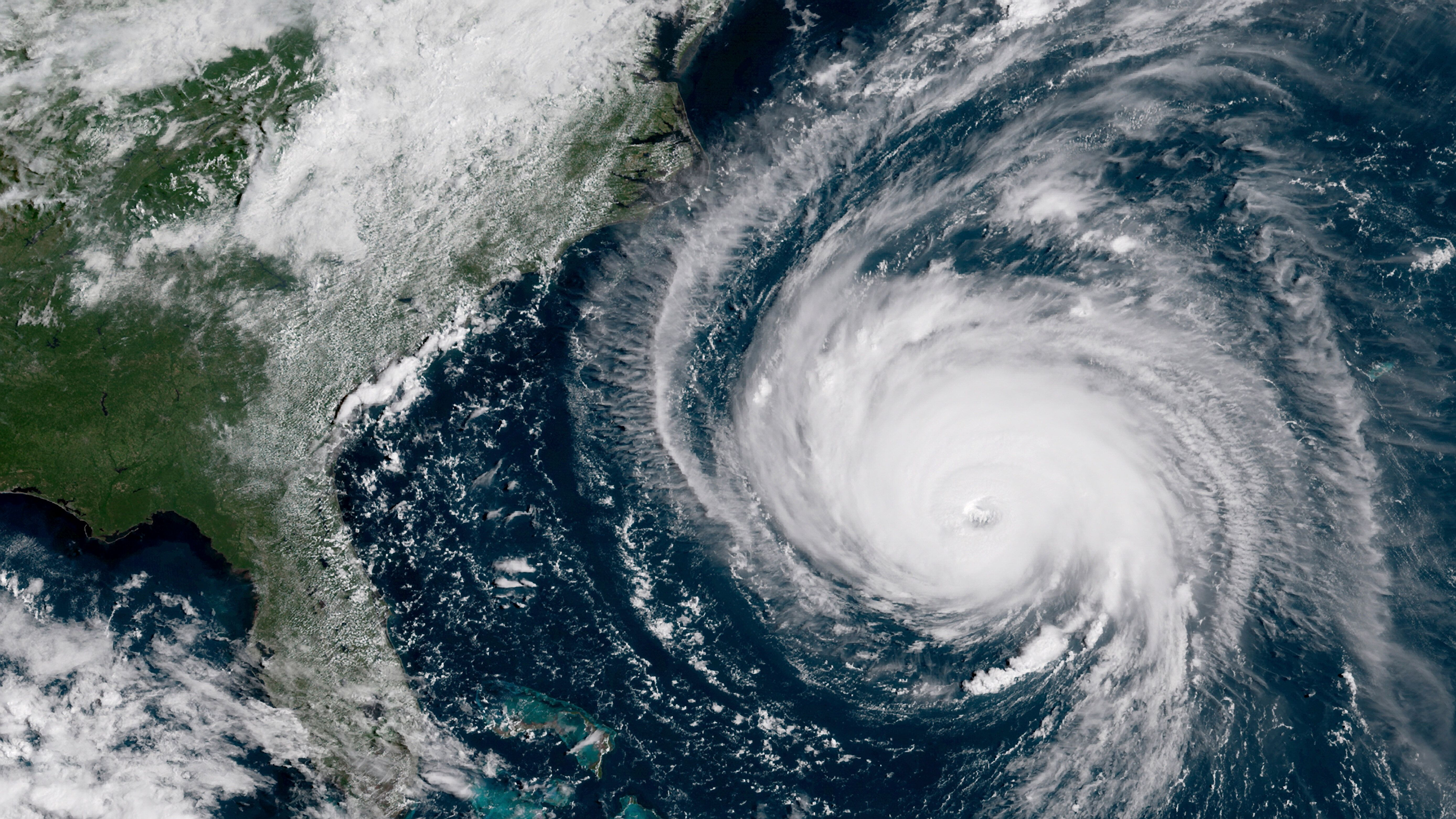 September 12, 2018 - Hurricane Florence moving closer to the coast of the Southeastern United States with a well-defined eye and outermost cloud bands.