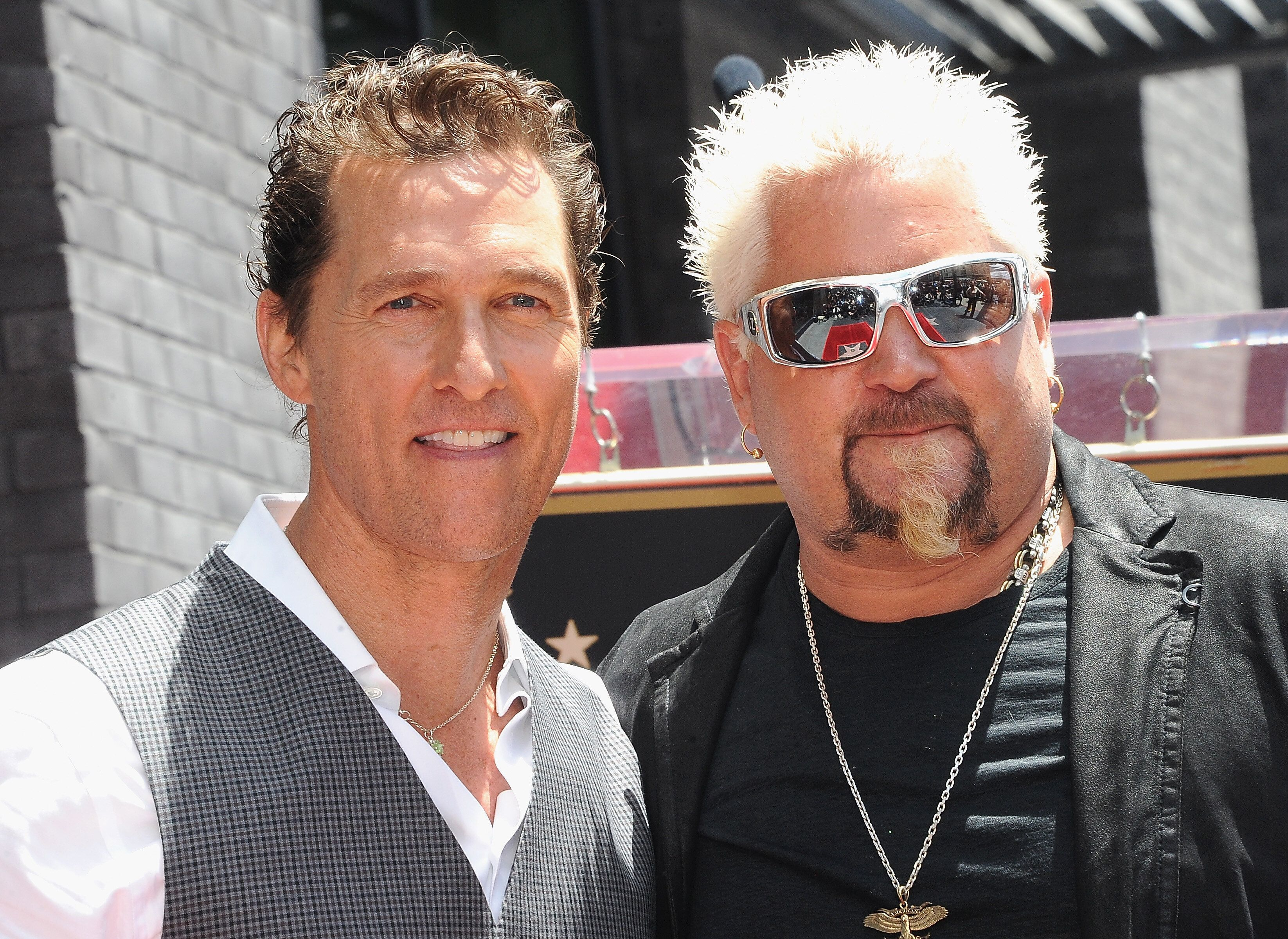 HOLLYWOOD, CA - MAY 22:  Matthew McConaughey with Guy Fieri at Guy Fieri's Star Ceremony On The Hollywood Walk Of Fame on May 22, 2019 in Hollywood, California.  (Photo by Albert L. Ortega/Getty Images)