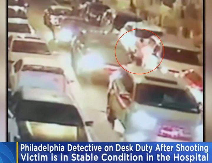 A Philadelphia man is in critical but stable condition after a plainclothes detective shot him while he was reportedly panhan
