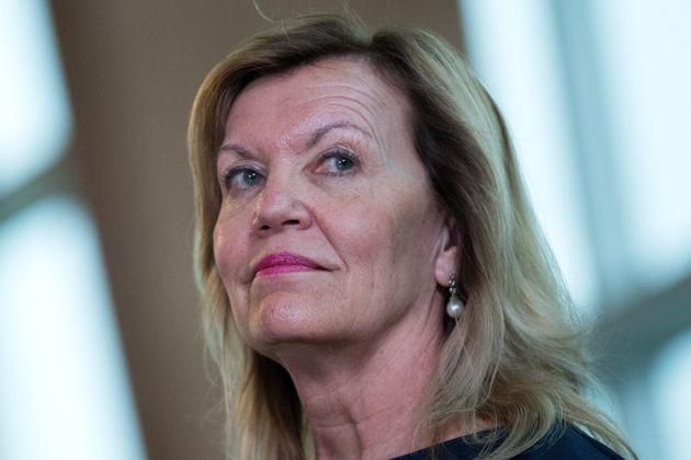 Ontario Minister of Health Christine Elliott listens during an announcement in Cambridge, Ont....