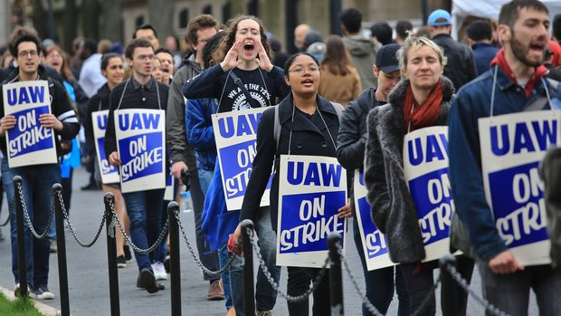 FILE - In this April 30, 2018 file photo, striking teaching assistants protest on the Columbia University campus in New York. Graduate students at the university are on strike to protest the school's refusal to negotiate with their newly formed union. (AP Photo/Bebeto Matthews)