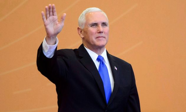 U.S. Vice-President Mike Pence arrives to a family photo at the Summit of the Americas in Lima,...
