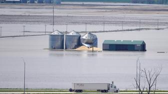Grain bins stand in floodwaters from the Missouri River, in Hamburg, Iowa, Friday, May 10, 2019. The House on Friday passed a $19 billion disaster aid bill that would deliver long-sought relief to farmers, victims of hurricanes and floods, and rebuild southern military bases, as Democrats try to dislodge the legislation from a Senate logjam over aid to hurricane-slammed Puerto Rico. (AP Photo/Nati Harnik)