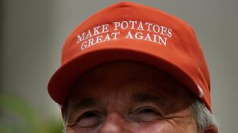 WASHINGTON, DC - MAY 23:  Dan Moss, of the National Potato Council, dons his 'Make Potatoes Great Again' hat before joining U.S. President Donald Trump in the Roosevelt Room at the White House May 23, 2019 in Washington, DC. As the U.S.-China trade war continues to hurt American farmers with tariffs on everything from peanut butter to soybeans and orange juice, the federal government announced Thursday it will give an additional $16 billion bailout to those most affected. (Photo by Chip Somodevilla/Getty Images)