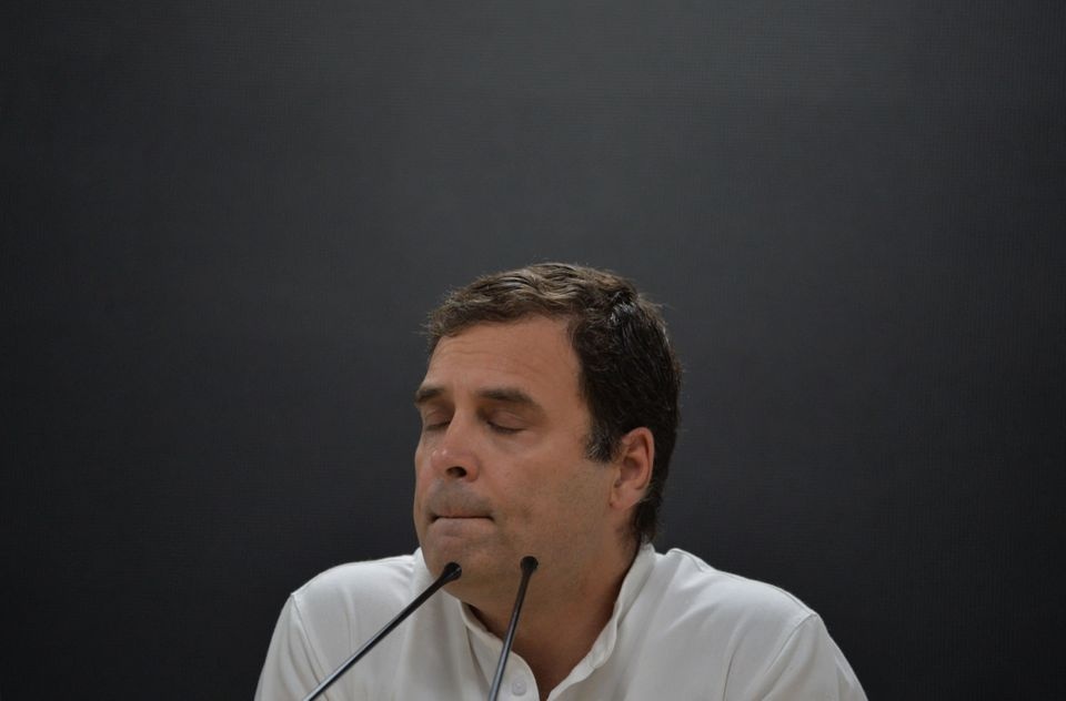 Indian National Congress Party president Rahul Gandhi gestures as he speaks during a press conference...