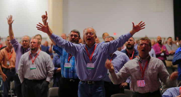 Southern Baptist Convention members worship during the denomination's 2018 annual meeting on Tuesday, June 12, 2018, in Dalla