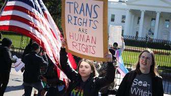 WASHINGTON, DC - OCTOBER 22: L.G.B.T. activists from the National Center for Transgender Equality, partner organizations and their supporters hold a 'We Will Not Be Erased' rally in front of the White House October 22, 2018 in Washington, DC. Members of the L.G.B.T. community and their supporters across the country mobilized quickly to show support for Transgender rights after the New York Times published news of an unreleased Trump administration memo that proposes a strict definition of gender based on a person's genitalia at birth. (Photo by Chip Somodevilla/Getty Images)