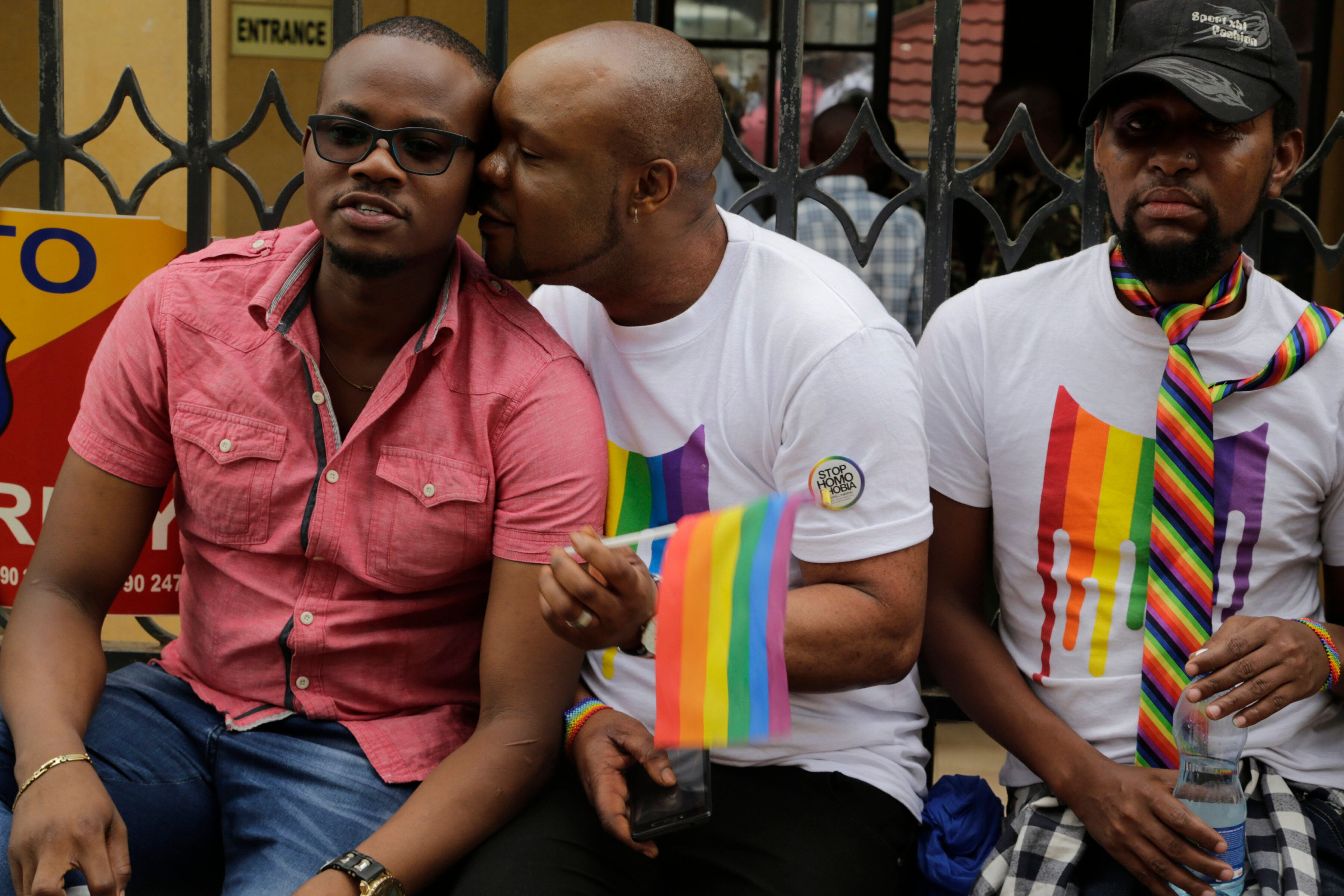 Kenya LGBT activists and their supporters gather outside the Milimani Court in Nairobi, Kenya, Friday, May 24, 2019. Kenya's High Court is due to rule Friday on whether laws that criminalise same sex relations are unconstitutional (AP Photo/Khalil Senosi)