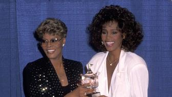 Singer Dionne Warwick and singer Whitney Houston attend the United Negro College Fund's 46th Annual Awards Dinner/Frederick D. Patterson Award to Whitney Houston on March 8, 1990 at the Sheraton Centre in New York City. (Photo by Ron Galella, Ltd./Ron Galella Collection via Getty Images)