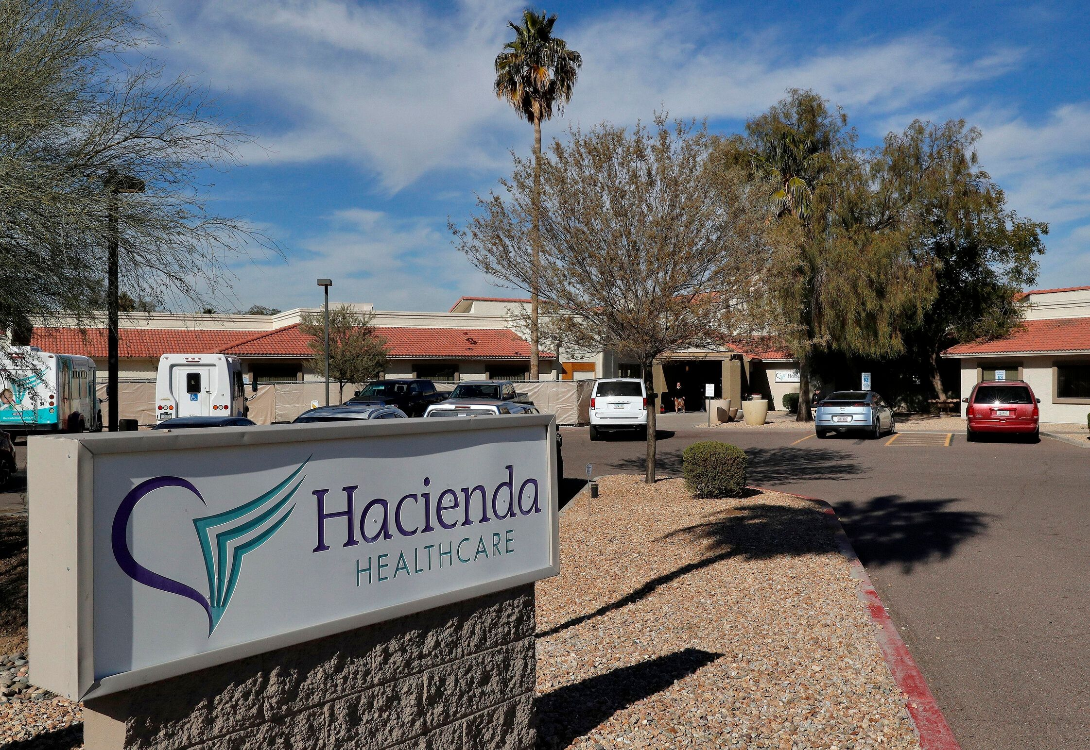 FILE - This Jan. 25, 2019, file photo shows the Hacienda HealthCare facility in Phoenix. A Phoenix long-term care facility where an incapacitated woman was raped and then gave birth now has a state license to operate. Hacienda HealthCare on Tuesday, April 30, 2019, said the Arizona Department of Health Services approved the license last week and it is valid for 11 months. (AP Photo/Matt York, File)
