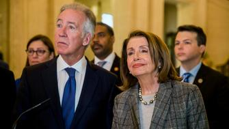 Nancy Pelosi speaker of the United States of House of Representatives faces the media with Richard Neal Chair to the House Ways and Means Committee, and members of an American delegation during a press conference in the Great Hall at Parliament Building in Belfast, Northern Ireland, Friday April 19, 2019. (Liam McBurney/PA via AP)