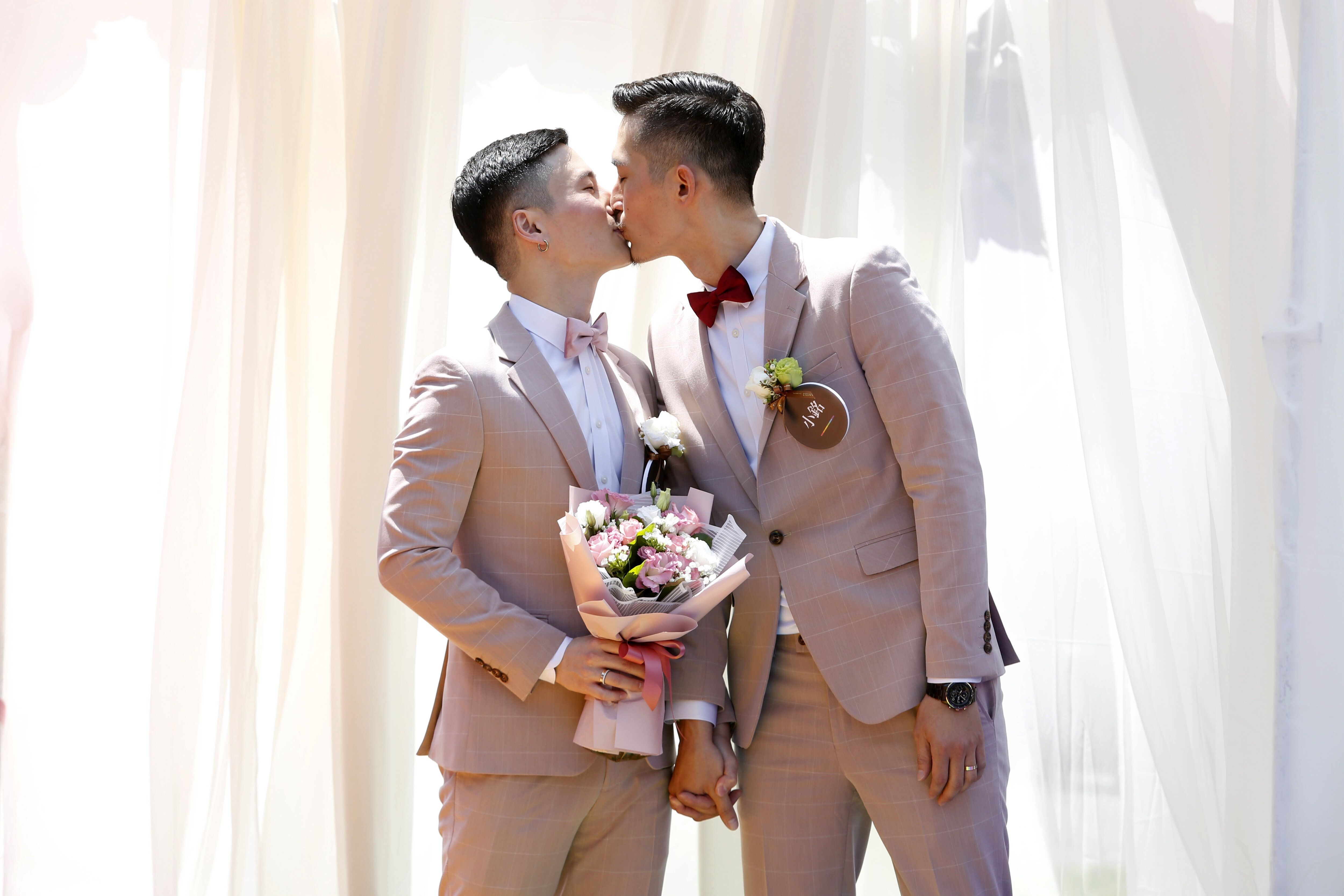A married couple shares a kiss during a pro same-sex marriage party organized by the Taipei City government and Marriage Equality Coalition Taiwan in Taipei, Taiwan, on Friday, May 24, 2019. Same-sex couples in Taiwan celebrated as it held the first gay marriages anywhere in Asia on Friday. Photographer: Ashley Pon/Bloomberg via Getty Images