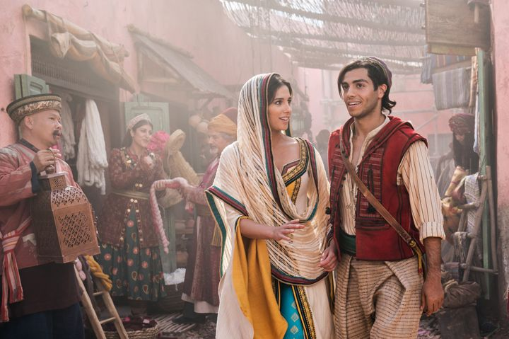 "<a href=""https://www.imdb.com/name/nm4305463/"" target=""_blank"" rel=""noopener noreferrer"">Naomi Scott</a>, as Jasmine and Mena Massoud as Aladdin on the mean streets of Agrabah."