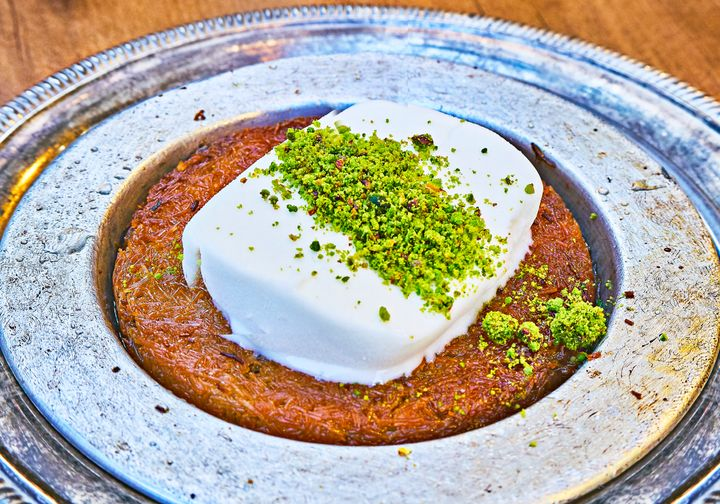 Knafeh is a delicious dessert often served with clotted cream or cheese.