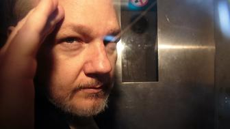 LONDON, ENGLAND - MAY 01: Wikileaks Founder Julian Assange leaves Southwark Crown Court in a security van after being sentenced on May 1, 2019 in London, England. Wikileaks Founder Julian Assange, 47, was sentenced to 50 weeks in prison for breaching his bail conditions when he took refuge in the Ecuadorian Embassy in 2012 to avoid extradition to Sweden over sexual assault allegations, charges he denies. The UK will now decide whether to extradite him to US to face conspiracy charges after his whistle-blowing website Wikileaks published classified US documents. (Photo by Jack Taylor/Getty Images)