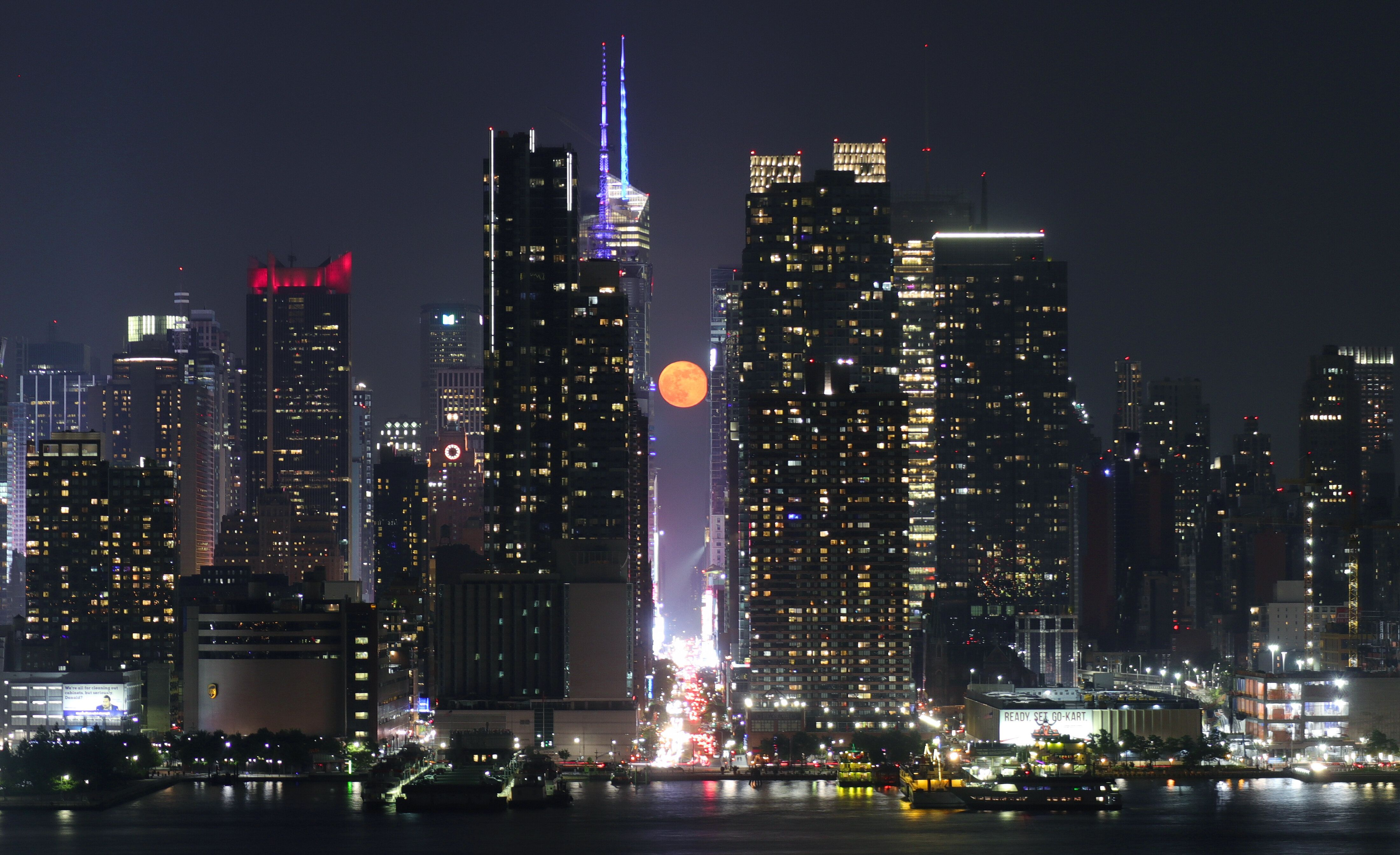 WEEHAWKEN, NJ - MAY 19: The moon rises above 42nd Street in New York City on May 19, 2019 as seen from Weehawken, New Jersey. (Photo by Gary Hershorn/Getty Images)