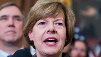 """UNITED STATES - MARCH 13: Sen. Tammy Baldwin, D-Wis., attends a rally with Democrats in the Capitol to introduce the """"Equality Act,"""" which will amend existing civil rights legislation to bar discrimination based on gender identification and sexual orientation on Wednesday, March 13, 2019. (Photo By Tom Williams/CQ Roll Call)"""
