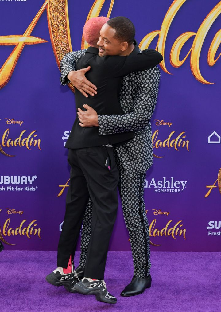Will Smith hugging his son Jaden after he finally showed up.