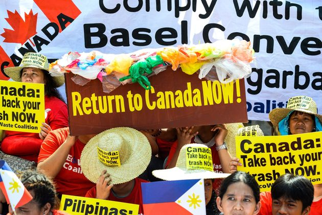 Environmental activists protest outside the Canadian embassy in Manila on May 21, 2019, to push the Canadian...
