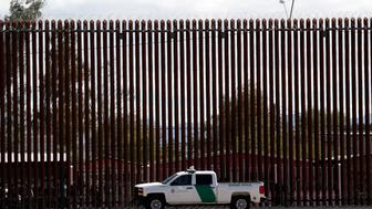 A U.S. Customs and Border Protection vehicle sits near the wall as President Donald Trump visits a new section of the border wall with Mexico in Calexico, Calif., Friday April 5, 2019. (AP Photo/Jacquelyn Martin)