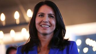 Presidential hopeful U.S. Rep. Tulsi Gabbard, D-Hawaii, smiles during a campaign stop at a brewery in Peterborough, N.H., Friday, March 22, 2019. (AP Photo/Charles Krupa)