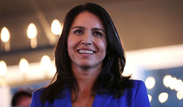 Presidential hopeful Rep. Tulsi Gabbard smiles during a campaign stop at a brewery in Peterborough, New Hampshire, on March 2