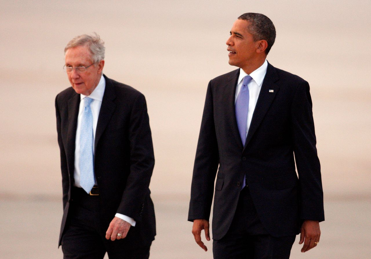 """Then-Senate Majority Leader Harry Reid (left) played a significant role in the repeal of """"don't ask, don't tell"""" in 2010, during the tenure of President Barack Obama."""