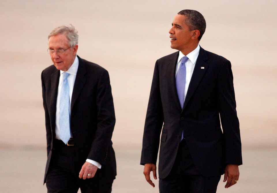 Then-Senate Majority Leader Harry Reid (left) played a significant role in the repeal of