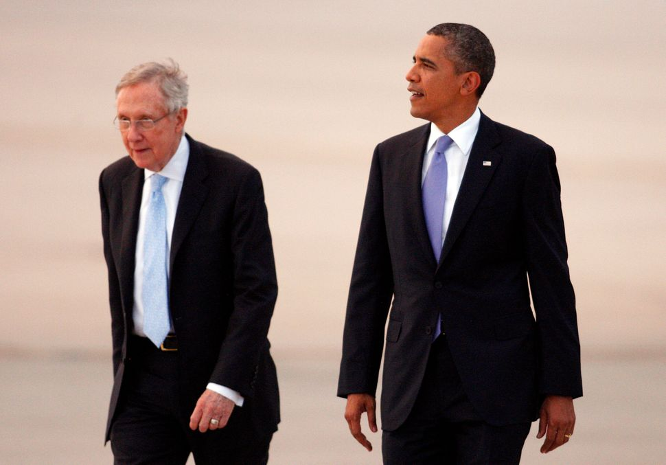 "Then-Senate Majority Leader Harry Reid (left) played a significant role in the repeal of ""don't ask, don't tell"" in 2010, dur"