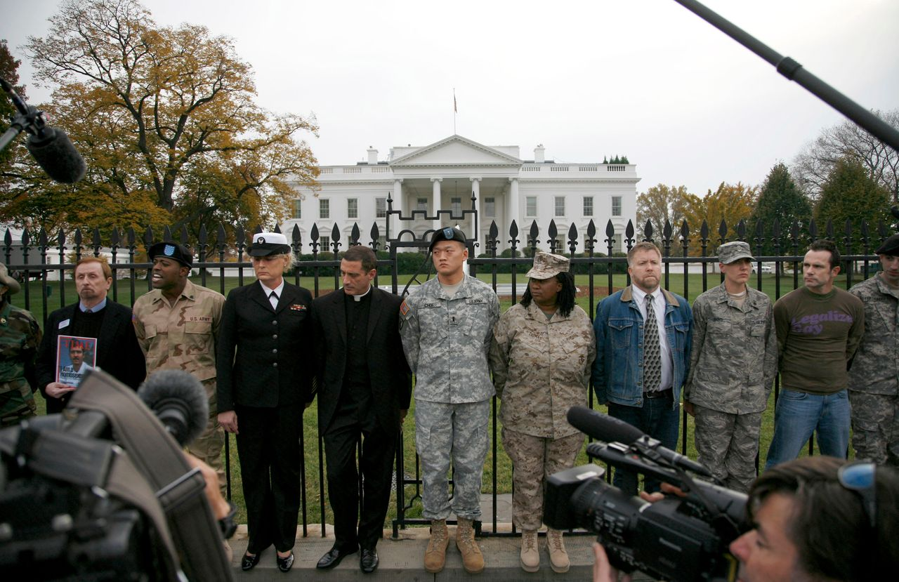 """Lt. Dan Choi (center) and others handcuff themselves to the fence outside the White House on Nov. 15, 2010, to demand that Obama keep his promise to repeal """"don't ask, don't tell."""""""