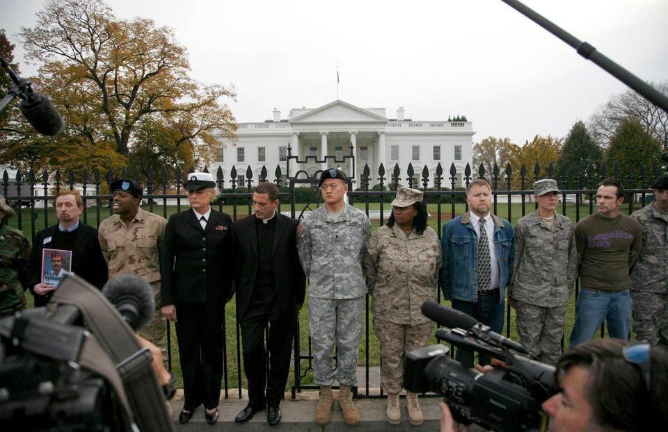 Lt. Dan Choi (center) and others handcuff themselves to the fence outside the White House on Nov. 15,...