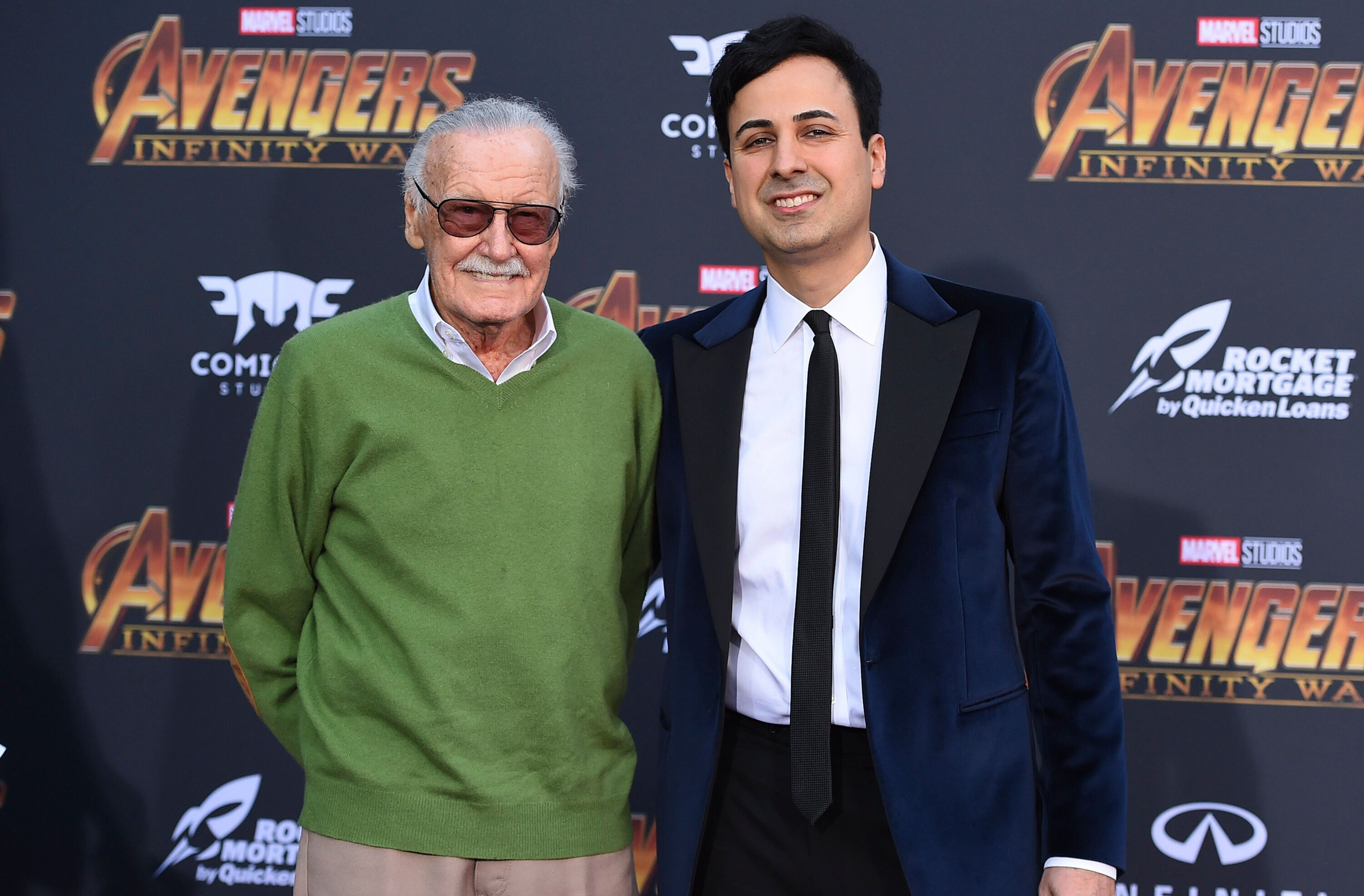 "FILE - In this April 23, 2018, file photo, Stan Lee, left, and Keya Morgan arrive at the world premiere of ""Avengers: Infinity War"" in Los Angeles. Attorney Alex Kessel entered a not-guilty plea in Los Angeles Superior Court on Monday, July 2, 2018, for Morgan, who is charged with calling 911 to report that detectives and a social worker conducting a welfare check on the 95-year-old Lee were burglars. (Photo by Jordan Strauss/Invision/AP, File)"