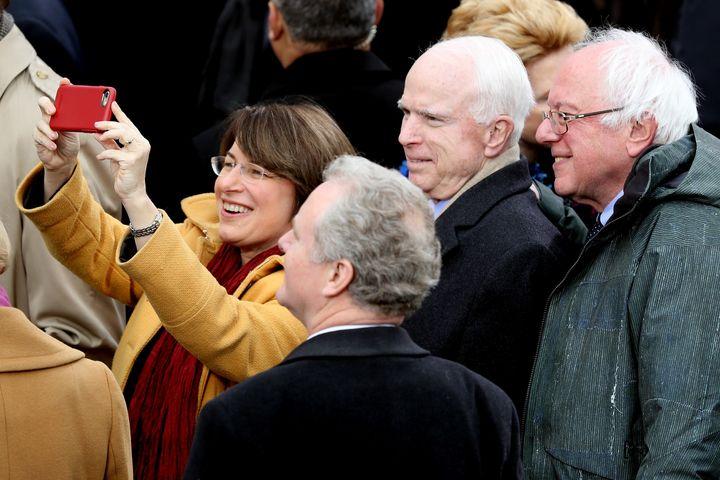 Sen. Amy Klobuchar (D-Minn.) takes a selfie with (from right) Sens. Bernie Sanders (I-Vt.), the late John McCain (R-Ariz.) and Chris Van Hollen (D-Md.) during President Donald Trump's inauguration in 2017.