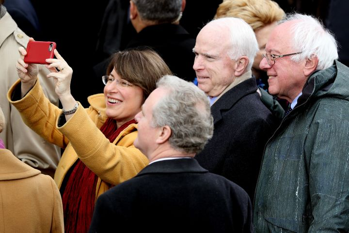 Sen. Amy Klobuchar (D-Minn.) takes a selfie with (from right) Sens. Bernie Sanders (I-Vt.), the late John McCain (R-Ariz.) an