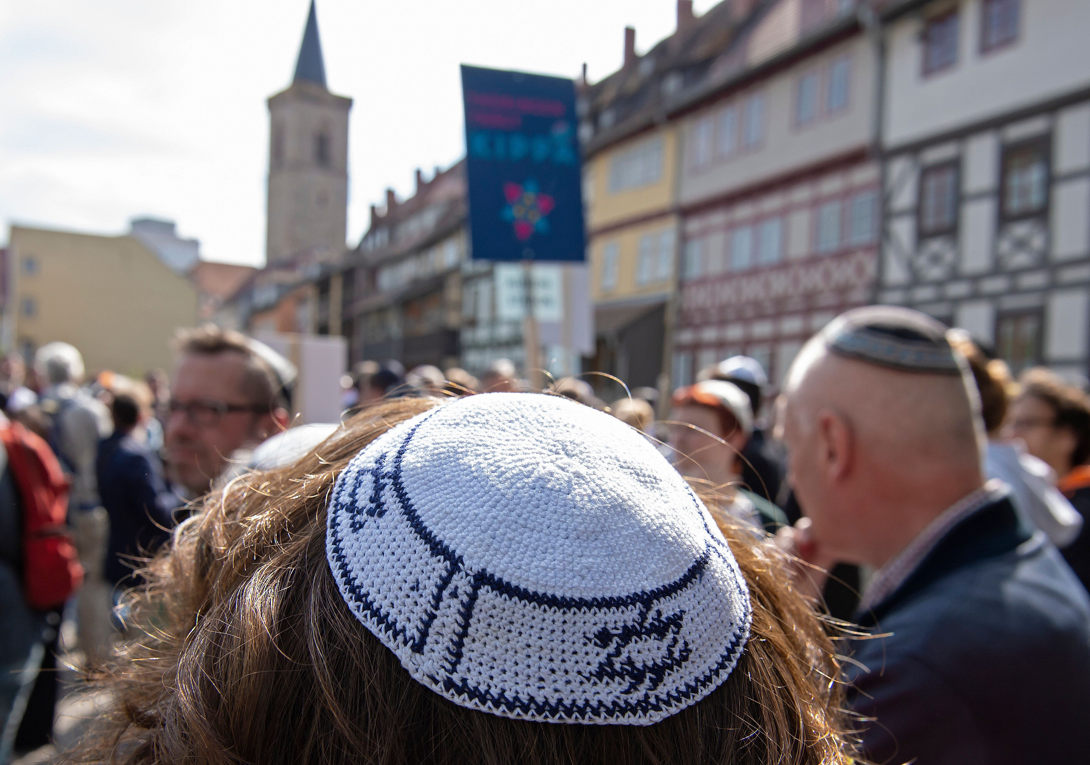 People of different faiths wear the Jewish kippah during a demonstration against antisemitism in Germany in Erfurt, Germany, Wednesday, April 25, 2018. (AP Photo/Jens Meyer)