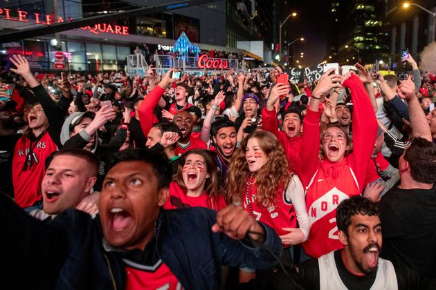 Fans react at Jurassic Park as the Toronto Raptors advance to the NBA finals after defeating the Milwaukee...