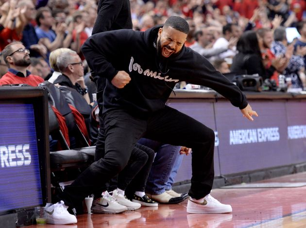 Drake reacts to a 3-point basket during Game 6 of the NBA basketball playoffs Eastern Conference finals...