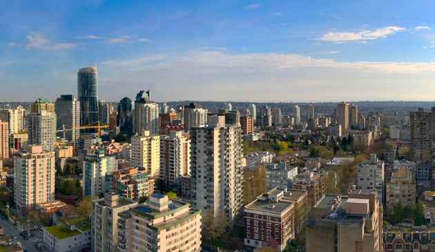 An aerial view of apartment and condo buildings in Vancouver's West End, with Robson Street on the