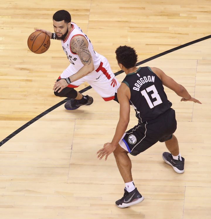 Fred VanVleet of the Raptors, left, faces off against Malcolm Brogdon of the Milwaukee Bucks during Game 6 of the NBA Eastern Conference Final at Scotiabank Arena on May 25, 2019 in Toronto.